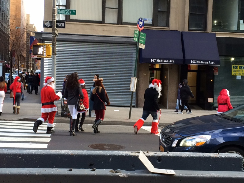 Santas crossing Madision Avenue.